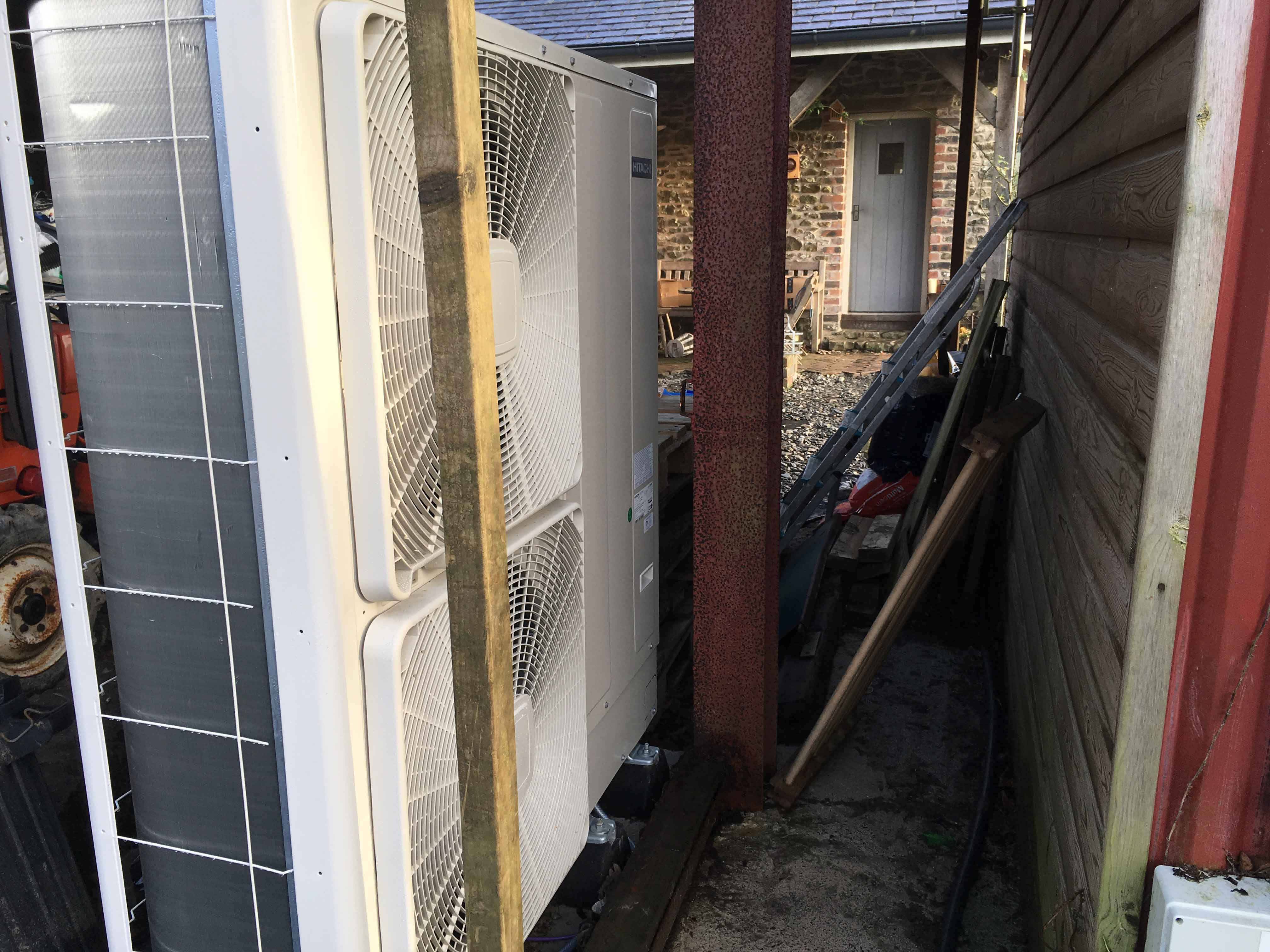 The Air Source Heat Pump (ASHP) is close to the house, keeping the costs down